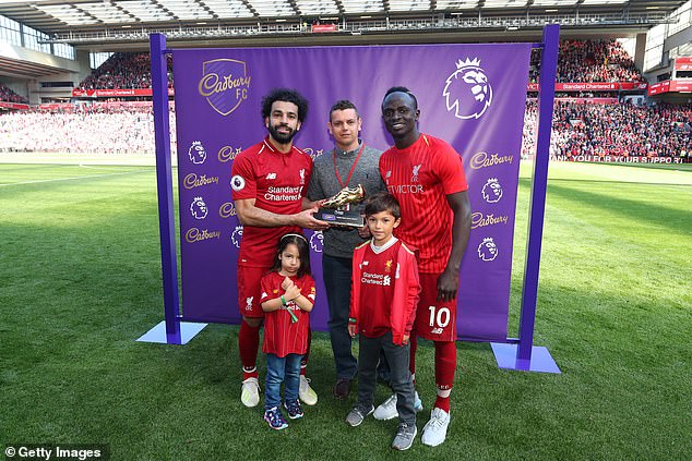 Salah and Sadio Mane are presented with the Golden Boot on the field at Anfield