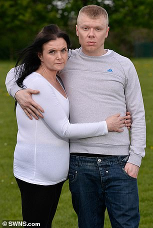 Mr Davison, 24, with his partner Ms Wane, 41