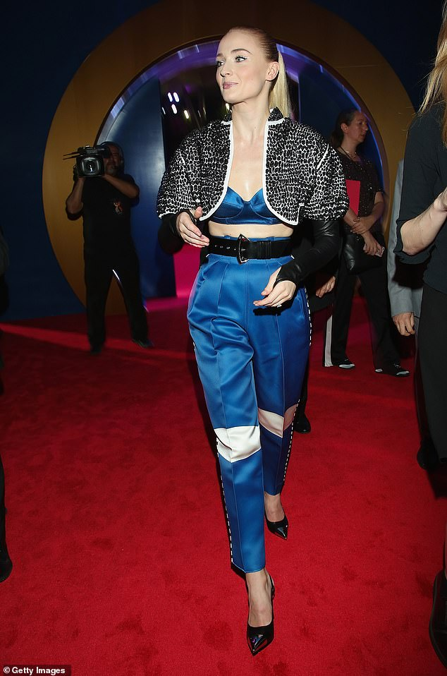 Strutting her stuff: Sophie looked sensational in the saucy look which comprised of a silk blue bralet with matching high-waisted trousers and a waist-cinching belt