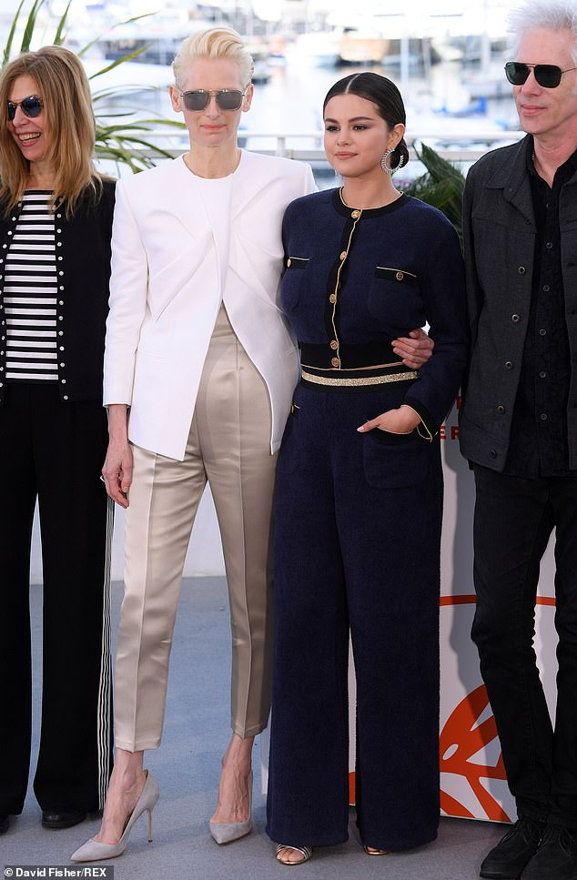 Suits you:Selena, 26, showed off her elegant sense of style in the fitted navy jacket and wide-legged trousers