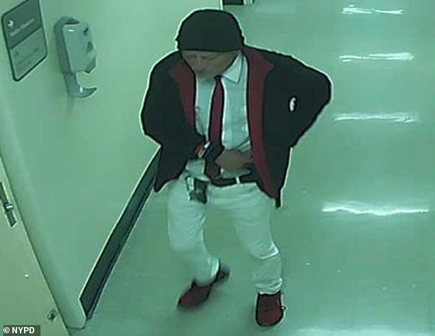 Caught: Police arrested Roberto Marcucci, 62, who they say is seen in this screenshot from a surveillance video leaving Lincoln Hospital in The Bronx after allegedly sexually assaulting a comatose patient