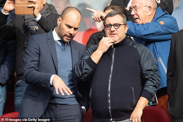 Raiola (R) attended PEC Zwolle's 3-0 defeat by Feyenoord in October to watch Scamacca play