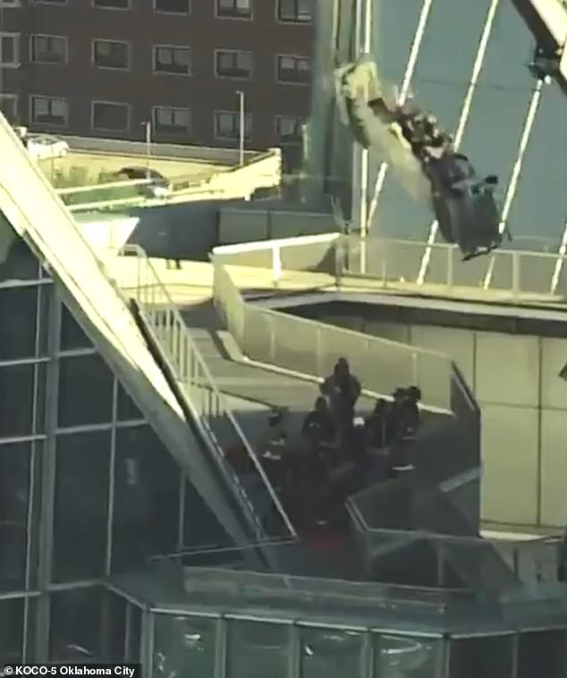The scaffold, which was dangling from a crane, banged against the sides of the 850-foot building that extended 20 feet above the roof as the men clutched the railing