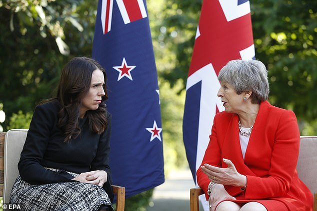 Representatives of Google, Facebook and Twitter were present at the meeting, hosted by French president Emmanuel Macron and New Zealand Prime Minister Jacinda Ardern (left). World leaders, including Theresa May (right) attended