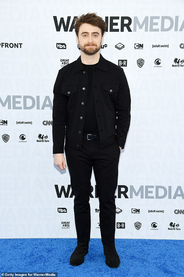 Handsome:He sported a rugged look for the event with his overgrown beard and styled brunette hair