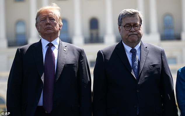 President Donald Trump stands with Attorney General William Barr during the 38th Annual National Peace Officers' Memorial Service at the U.S. Capitol, Wednesday, May 15, 2019, in Washington. The White House counsel asked Judiciary Chairman Jerold Nadler to halt his investigation