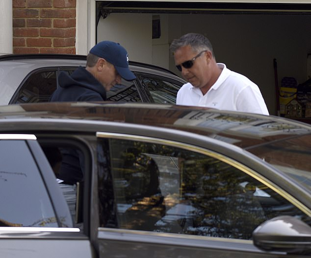 Mr Kyle, was spotted at his Berkshire home wearing a baseball cap and navy blue hoody, as calls amplify for the Jeremy Kyle Show to be axed