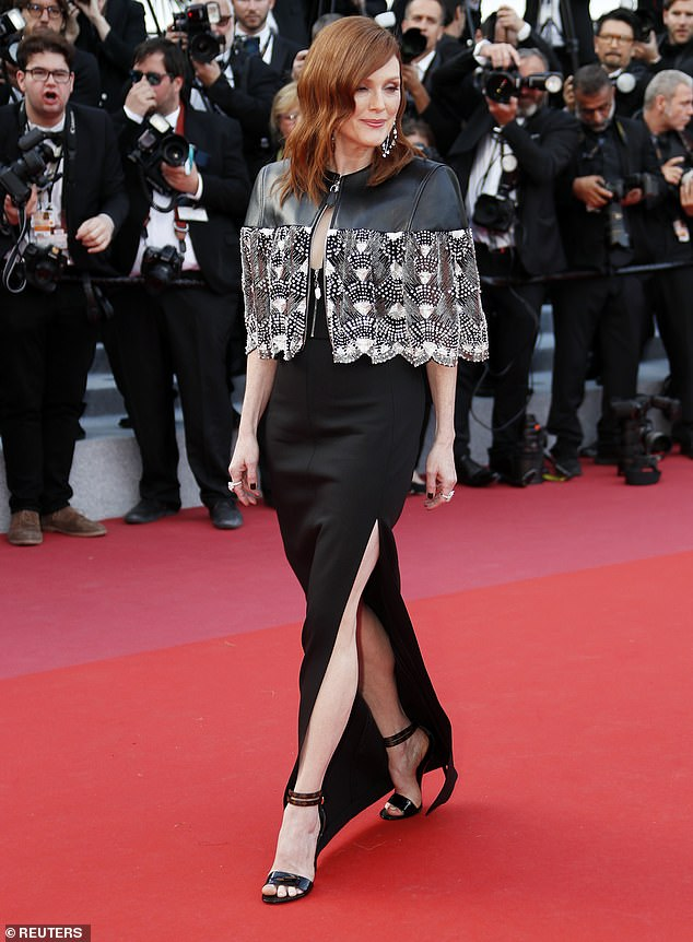 Red carpet ready: Her dress was teamed with a leather cape-like bolero with shimmering embellishments