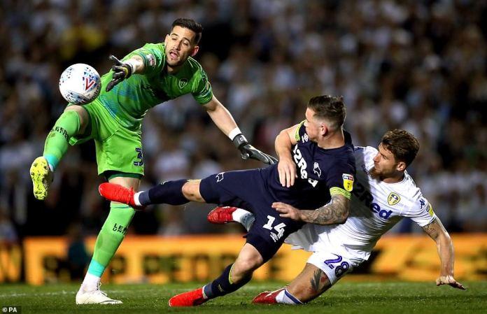 Kiko Casilla (left) flaps at a ball delivered into the box asGaetano Berardi grapples with Derby striker Jack Marriott