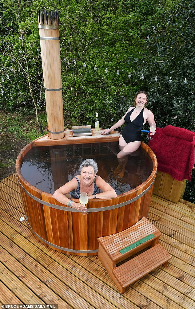 Susan Green, pictured with her daughter Amy, loved hercedar wood-fired hot tub so much she bought another one which could be used by guests at herMongolian yurt