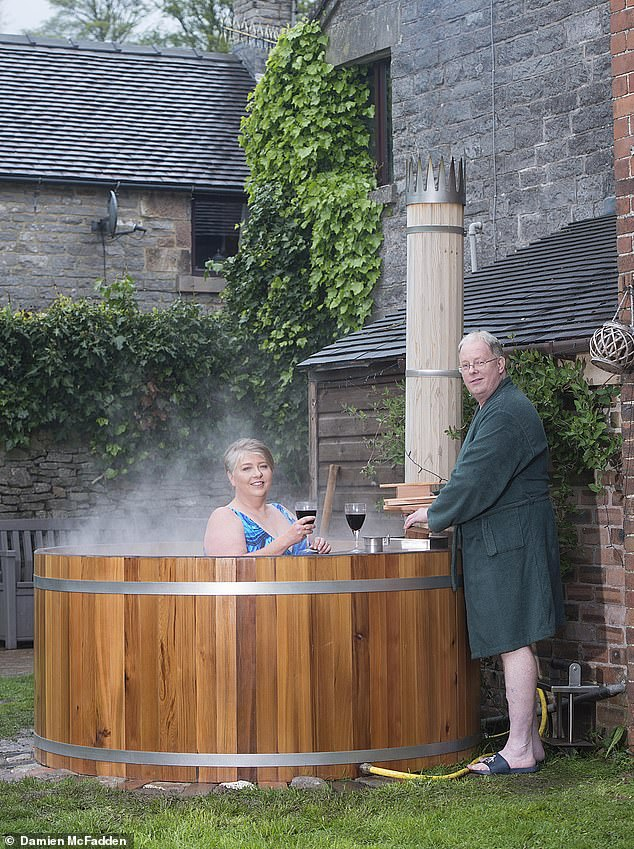 Peter Fox, pictured with his wife Alison, made his wood-fired hot tub in 2007 and former PM David bought one of his tubs recently