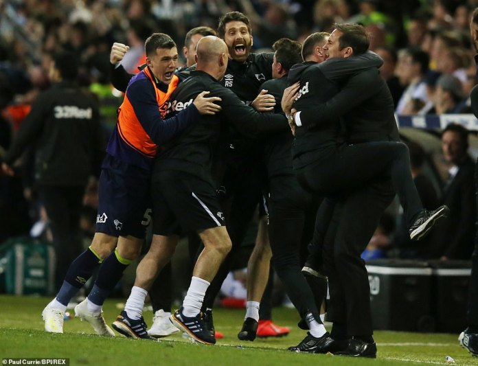 Derby manager Frank Lampard and his staff celebrate wildly on the touchline after Marriott's late strike
