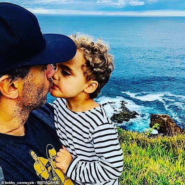 Proud father: New Jersey-born actor Bobby is pictured with the couple's son Rocco