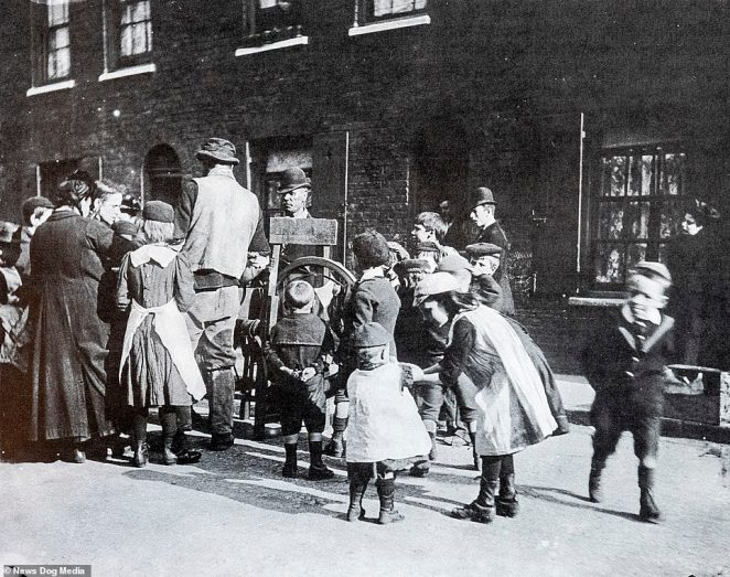 This street scene from 1893 was taken as part of the photographer's series called 'the children of the poor in the Nineties'. The recently unearthed images were taken across London by Paul Martin, who documented their desperate lives