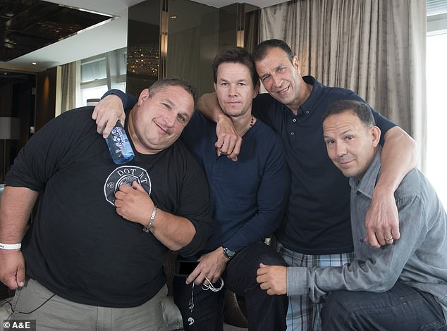 Laun, who is close friends with actor Mark Wahlberg and an extreme eater from Boston, Massachusetts, will fight under his ring nickname 'Nacho Extreme'. Pictured l-r: Henry 'Nacho' Laun, Mark Wahlberg, Johnny 'Drama' Alves and Henry Penzi of A&E's Wahlburgers