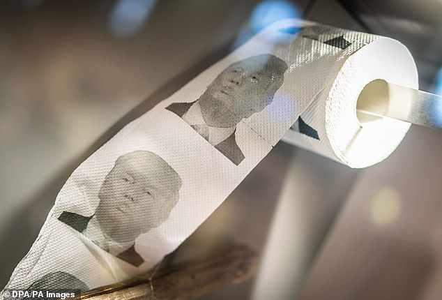 One Taobao seller gives out free toilet rolls with Trump's image to buyers of the brushes. Pictured, similar toilet paper is on display at the an exhibition in Germany in April