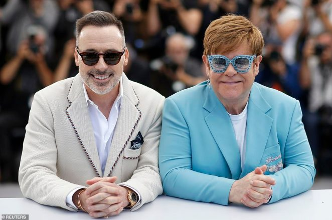 His love: Elton and his husband David Furnish (left) have co-produced the movie together
