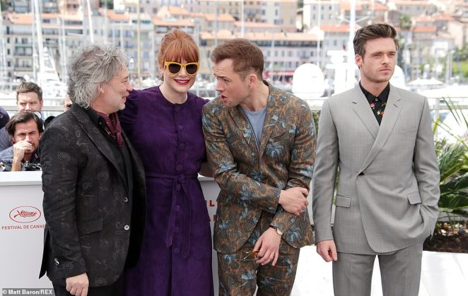 Suited and booted: Taron larked around with Dexter and Bryce, while Richard gazed out into the distance