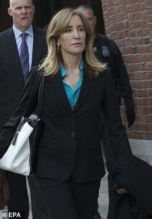 Felicity Huffman seen leaving the same courthouse in the Massachusetts city on April 3