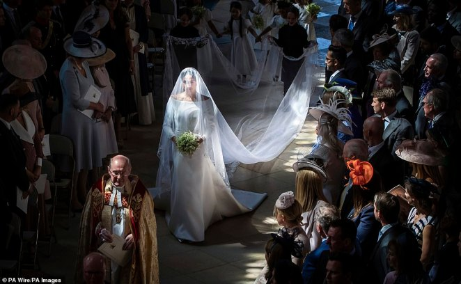 Meghan Markle walks down the aisle in St George's Chapel at Windsor Castle during her wedding to Prince Harry. The two recently gave birth to their first child, naming him Archie Harrison Mountbatten-Windsor