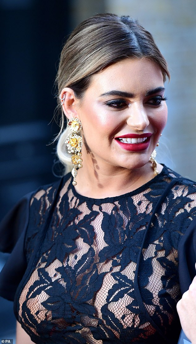 Pretty: The look was finished with statement gold earrings
