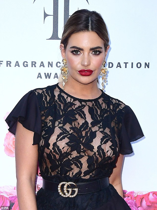 Pouty: Her features were generously made up with bronzer, red lipstick and thick mascara