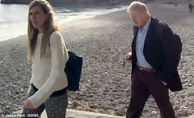 His second marriage of 25 years ended last summer but he is happily living with his new girlfriend, Carrie Symonds (pictured with Boris in Italy)