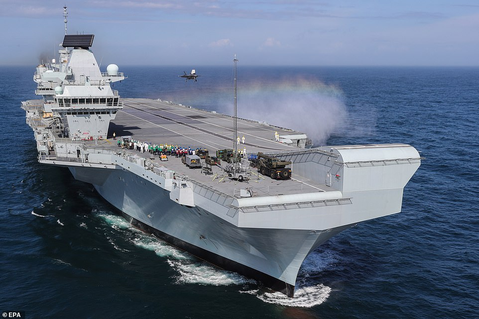 HMS Queen Elizabeth (pictured) is one of the largest warships ever built for the Royal Navy and capable of carrying up to 60 aircraft