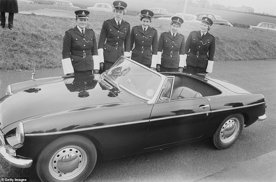 The situation changed in the 1970s with the creation of the Equal Pay Act 1970 and Sex Discrimination Act 1975. By 1973 the Met had integrated all of its female police officers. Pictured is London's first squad of mobile policewomen posed together in uniform behind a British Motor Corporation MGB sports car at a Metropolitan Police press launch event in the capital on April 6, 1963