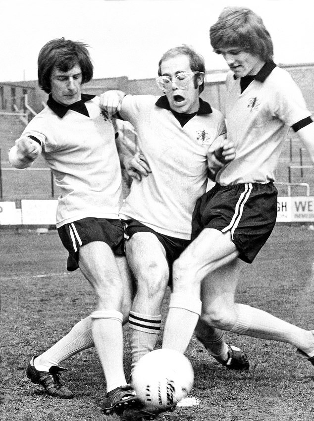Music legend John pictured playing football - as he did on a summer trip to China in 1987
