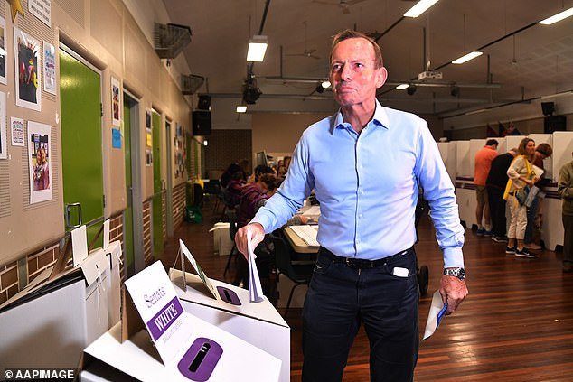On Saturday morning Mr Abbott (pictured voting) said he's 'not too cocky' but quietly confident about being re-elected