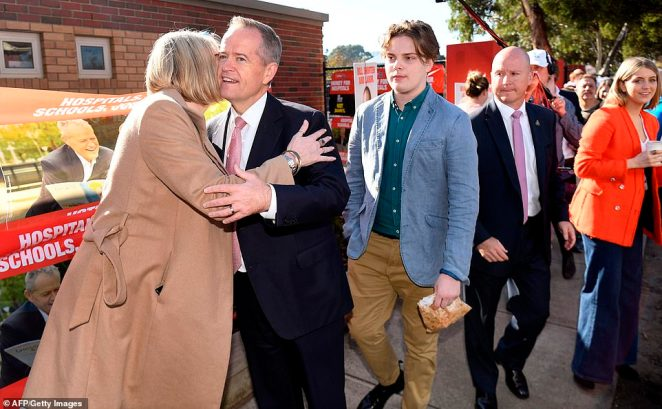 Bill Shorten speaks to voters at a polling station after casting his vote in the Melbourne suburb of Moonee Ponds