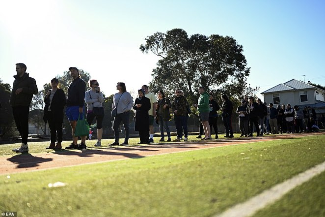 People queue to cast their votes at Moonee Ponds West Primary school during Election Day in Melbourne