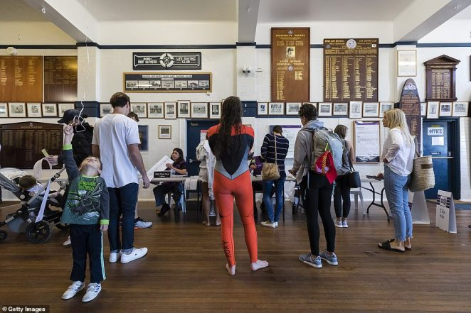 SYDNEY, AUSTRALIA - MAY 18: A woman casts her vote while still in a wetsuit at the Bondi Surf Life Saving Club, in the seat of Wentworth, on May 18, 2019 in Sydney, Australia. Australians head to the polls today to elect the 46th Parliament of Australia, with a tight battle between incumbent Prime Minister Scott Morrison of the Coalition party and Labor Leader, Bill Shorten. The Coalition party has led government since 2013. (Photo by Brook Mitchell/Getty Images)