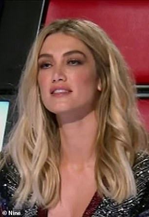 Claims: Last year, a leading plastic surgeon suggested Delta has had a nose job and had filler injected into her cheeks and lips. Pictured on The Voice