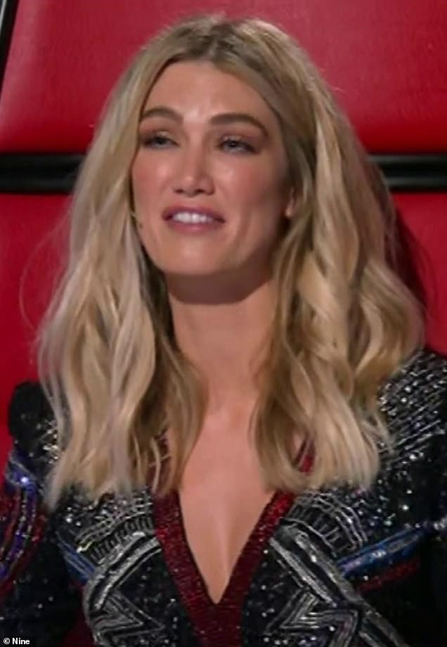 'What's happened to Delta's face?' The Voice fans accused Goodrem, 34, of getting cosmetic work after the singer showed off a VERY plump pout and smooth skin on launch night. Pictured on Sunday