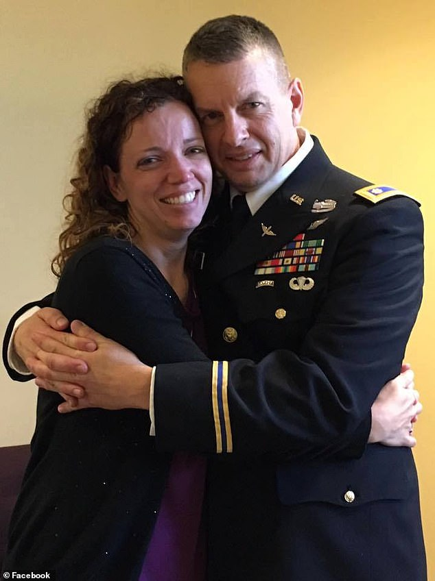 Martin is pictured with Laura Spencer - who is presumed to be his girlfriend- dressed in ceremonial military garb