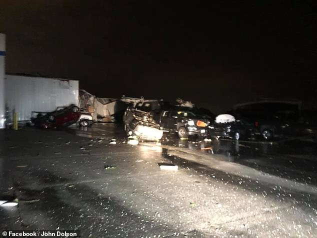 Photos showed overturned cars at the Riley Chevrolet Buick GMC dealership (pictured) located on Christy Drive