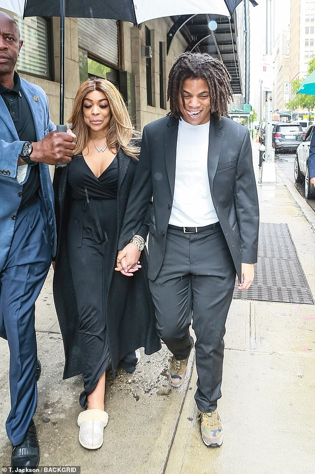 Wendy Williams and son Kevin Williams Jr. are all smiles while they leave her Chelsea studios hand in hand in a show of solidarity two days after his arrest for allegedly punching his father
