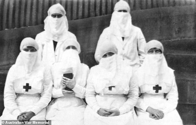 Lives could have been saved if doctors had recognised the danger of Spanish flu when it first appeared a few years before the pandemic, experts say (Pictured: Australian Red Cross volunteers in Sydney during the flu outbreak in 1918)