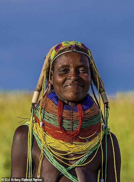 A Mwila woman poses for the camera