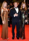Sylvester Stallone poses with his wife and daughter at Cannes