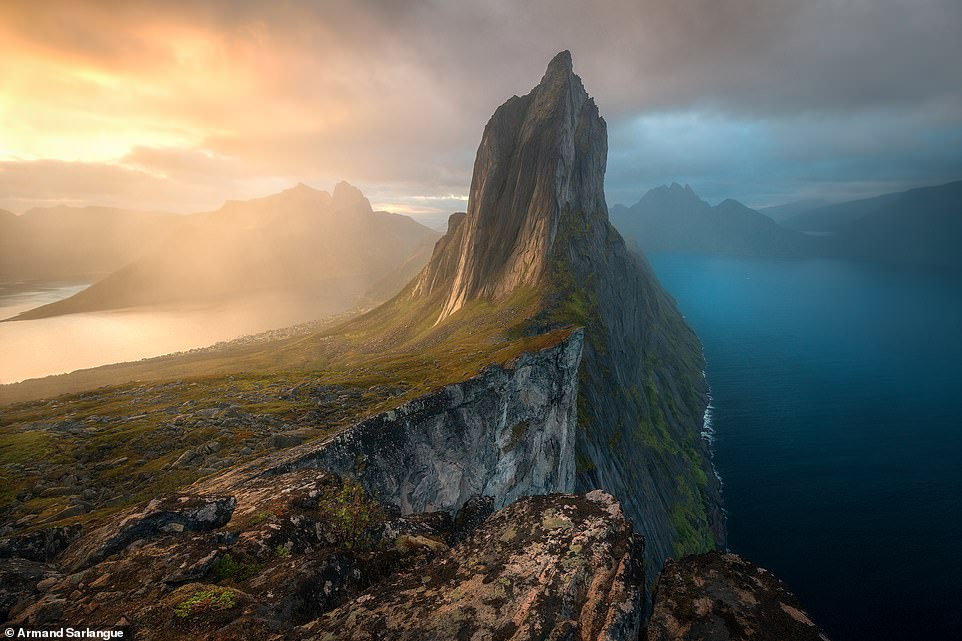 Armand Sarlangue scooped top prize in the landscapes, waterscapes and flora category with this jaw-dropping shot of Senja Island in Norway. Although it's not the country's best-known destination, it is quickly growing in popularity. One mountain in particular is largely responsible for that fame. Towering nearly 650 metres (2,100 feet) above the sea, Segla is a peak that epitomizes the ruggedness and wildness of northern Norway. Here, reindeer still roam the tundra while humpback whales, orcas, and sea eagles pursue herring along narrow fjords