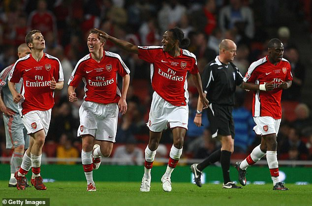 Arsenal striker Sanchez Watt (center) celebrates his goal in the first leg
