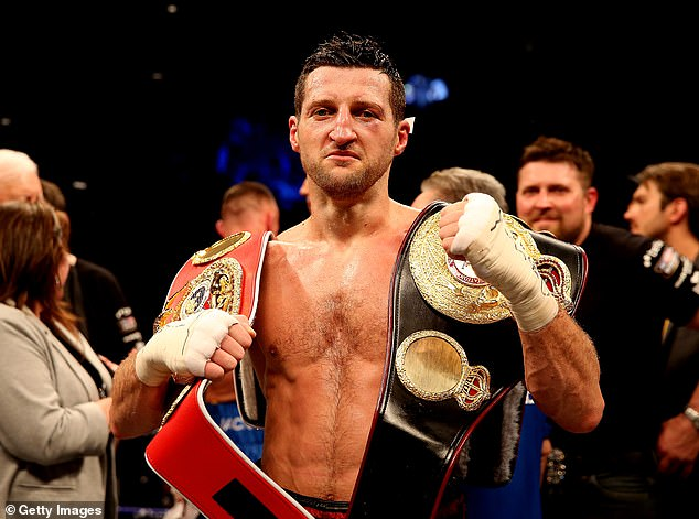 Carl Froch poses with his IBF and WBA belts after defeating Mikkel Kessler at the O2 Arena