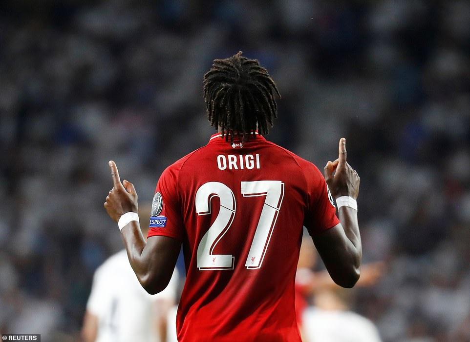 Origi points to the sky after coming off the bench to secure yet another famous Champions League win for the Anfield club