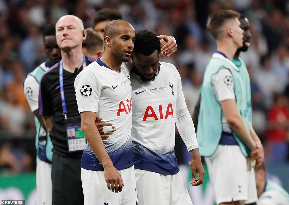 A tearful Lucas Moura comforts England defender Danny Rose at full-time after Liverpool secured the Champions League