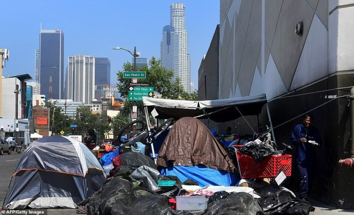 The homeless crowd on the sidewalk in downtown Los Angeles on Skid Row. On May 29, the City of Los Angeles agreed to allow homeless people to keep their property and not have it seized, provided the items are not bulky or unsafe.