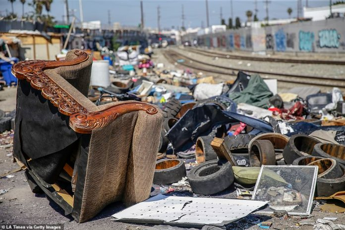 The city said it would have sofas, refrigerators and other big items in the downtown area, called Skid Row, which is 50 blocks away. Lots of garbage remain near the intersection of 25th St. and Long Beach Ave