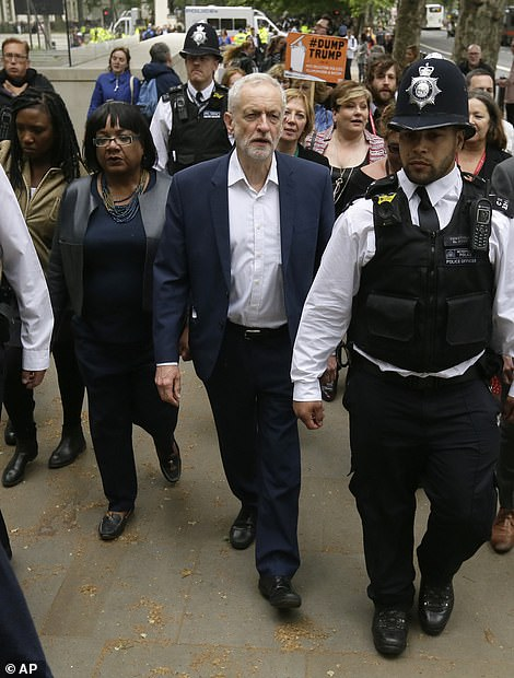 The leader of Britain's opposition Labour party Jeremy Corbyn leaves the area after delivering a speech